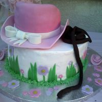 Pink Cowgirl Hat Cake The bottom cake was super moist chocolate chocolate chip cake filled with raspberry and iced with vanilla buttercream. Green grass is green...