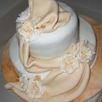 Elegant Fondant Chocolate cake covered with fondant. Drape is also made of fondant with gumtex for texture. Vibrant flowers are made of fondant as well.