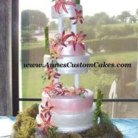 Six Tier Wedding Cake My airbrush broke so I ended up having to paint the cake with the Super Pearl. All decorations are gumpaste.