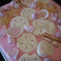 Seashell Cake gumpaste seashells on buttercream frosted cake