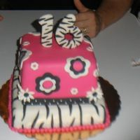 Zebra Print  My daughter's 16th bday cake. Hot Pink and black with zebra stripes and retro flowers. Pumpkin cake, toffee bc, and decorated in MMF...