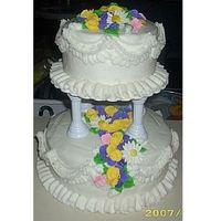 2 Teir Cake With Royal Icing Flowers all of the flowers are made with royal icing. Some of the daisies are made with gum paste. The rest is buttercream. I made this to practice...