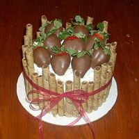 Chocolate Covered Strawberries - Chocolate Cake. Inspiration from someone on C.C. Thank you so much for all of the great ideas This cake has chocolate mocha pirouette cookies around the...