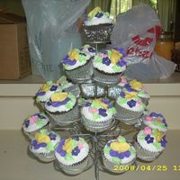 Cupcakes cupcakes with royal icing flowers I made at the last minute for a friend. Gotta love the convience of pre-made flowers.