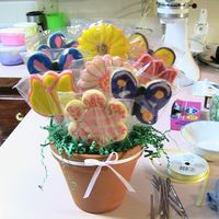 First Cookie Bouquet  First cookie bouquet ever. NFSC cookies, sugar glaze recipe off Allrecipes.com and colored with wilton color pastes. The extra green hangy...