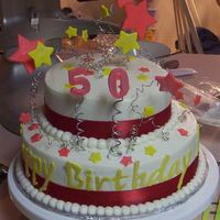 50Th Birthday Cake  Cake made for a co-worker's mom. Top tier is vanilla cake, bottom is classic white cake. I backed the ribbon with the Glad seal wrap...