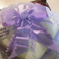 Another Present Cake  This was ordered for a co-worker of mine. Cake is buttercream (they didn't want fondant) so it was a challenge. The bow, curly cues...