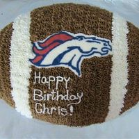 Football/denver Broncos Cake   Chocolate cake w/choc. butter cream, FBCT of Bronco's image.