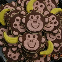 Monkey Business Monkey cookies for baby's first birthday. I couldn't resist throwing in a couple of bananas for fun!