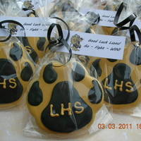 Lion Paw Cookies Cookies made for the boys basketball team . The logo on the tag is the school's mascot which I pulled off of the high schools webpage...