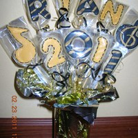 Senior Night Cookie Bouquet Cookie bouquet for HS senior night. The student was a 4-yr band member, therefore a couple music-related cookies.