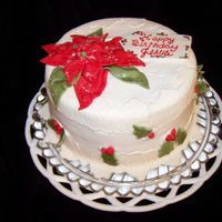 Happy Birthday Jesus Red Velvet cake frosted in buttercream and decorated with fondant accents.