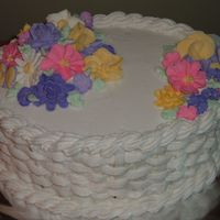 My First Basket Weave Cake This is my first attempt at a basket weave. The Cake is frosted in Buttercream with Royal Icing Flowers. I was pretty happy with the way it...