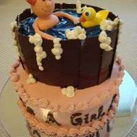 It's Bath Time! Cake covered with swiss meringue buttercream. Bucket is covered with chocolate, baby girl & duck are made from fondant. I have so much...