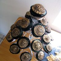 Pirate Coin Cupcakes Aztec Gold coin made out of chocolate fondant on cupcakes