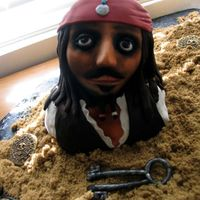 Jack Sparrow Used lots of rice crispies on his head, covered that with fondant, sculpted eye sockets, nose, mouth, and cheeks by hand. Wanted to give...