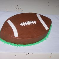 "Groom's Cake Cut this football out of a 12"" square chocolate cake. Iced with chocolate buttercream."