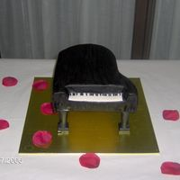 Piano This is the groom cake that went with my melting cake (stairway to love/fountain). Chocolate cake with choc. b/c w/ chc MMF painted black....