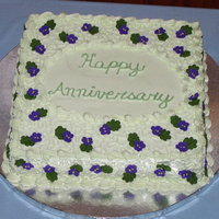 Anniversary Cake With Violets And Cornelli Lace I like the color on this cake - the photo isn't really true to color. Violets are deep purple, and the green is soft. Cornelli Lace...