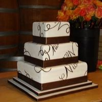Script Wedding Cake This a 3 tier square covered in a marshmallow fondant. The names of the bride and groom have been painted on in a variety of directions all...