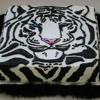 White Tiger Cake  This is a yummy chocolate cake with mint buttercream. The tiger is piped with dark chocolate buttercream colored black. The cake base is...