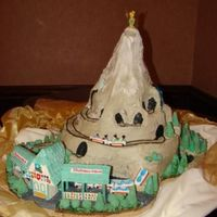 Matterhorn Ride Wedding Cake This cake was a wedding cake for a couple who love to go to Disneyland. They asked us to create a cake to replicate the Matterhorn ride....