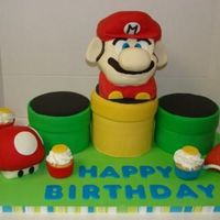 Super Mario Bros Ds Cake The 3 pipes are made of chocolate cake. The mario, shell, and mushroom are made with rice cereal covered in fondant. Then the cupcakes have...