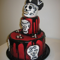 Dia De Los Muertos Cake The skull on top is modeled out of rice krispie treat, covered in fondant, with royal icing detail. The drips were made from Dove Fudge Ice...