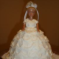 Doll Cake We used a barbie doll and a glass 8qt measuring cup to come up with this cake.