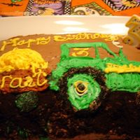 John Deere Cake My son loved 2 things when he was 3; tractors and chocolate. Hence, this cake. The dirt is crushed Oreos.