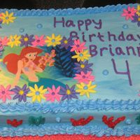 Img_1123_2.jpg buttercream with fondant accents with edible image of little mermaid.