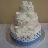 Php8Rjgptpm.jpg wedding cake covered in fondant with fondant bows, accents and silver dragees.