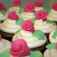 Pink Roses spice cake cupcakes with buttercream icing and fondant roses and leaves