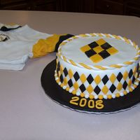 Black & Gold Graduation Cake I did this cake for a fund raiser for a project graduation party. It is a white chocolate cake with white chocolate filling. I was going to...