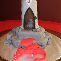 "Knight Cake With Dragon I made this for my son's 4th birthday. The ""rock"" base is yellow cake covered in marbled fondant. The castle is rice krispie..."