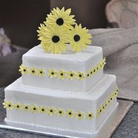 Sunflower Bridal Shower Vanilla Cake with Vanilla Buttercream. It has gumpaste sunflower details!