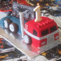 Optimus Prime Transformers Cake This was done last minute for a friend's baby turning one. Not the amount of detail I'd like to put into a cake like this but a...