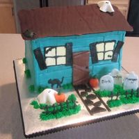 Haunted House Made this for a family who was celebrating 3 birthdays around this time (hence the names on the tombstones.) Choc. cake. Siding, door,...