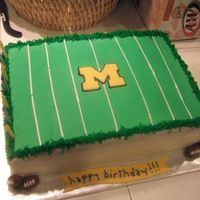 Michigan Football Field Cake. A simple cake for my hubby who's a huge Michigan football fan. WASC cake w. bc dream topped with green fondant field. Footballs are...