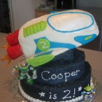 "Buzz Lightyear Rocket Ship. This cake was for my 2 year old's birthday. He is obsessed with Buzz Lightyear so after having ""caker's block"" for..."