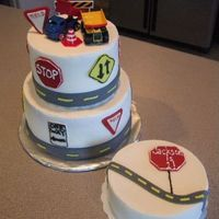 Traffic Signs Cake. Made this for a little boy's first birthday. Iced in BC. Fondant signs and road.