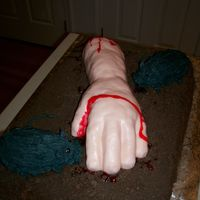 Severed Arm With Rats Cake Full size chocolate sheet cake with chocolate buttercream icing and crushed chocolate graham crackers for dirt, severed arm modeled out of...