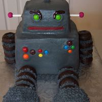 Robot Cake Robot cake made for a 3 year old's birthday. Body is 2 6 inch square cakes stacked, head is a smaller square cut from a 6 inch cake,...
