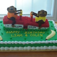 Monkeys On A Seesaw Cake Full Shhet Cake with Seesaw carved from large loaf pan amd monkeys made of cake as well. Decorated in buttercream. Bananas are molded of...