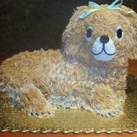 Puppy Dog Cake Puppy dog birthday cake decorated in buttercream with ribbon bow.