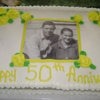 50Th Wedding Anniversary 1/2 sheet white cake with bc icing. The pic was printed from my pc and had contact paper attached to each side. It was an easy cake to do...