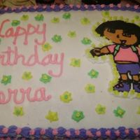 Dora The Exlplorer 1/2 sheet white cake with a almond flavored bc icing and a fbct