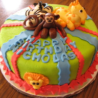Zoo Cake  This is a cake I made for a boy's first birthday. They wanted bright colors, stripes and zoo animals. Thanks to the members of cake...