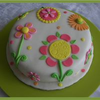Fantasy Flowers Cake  9 inch carrot cake covered with MMF. All flowers are fondant. I took this idea from one of Lindy Smith´s books. The client told...