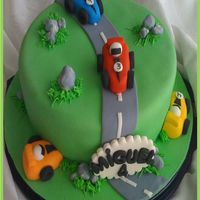 "Racecars Cake 9 inch carrot cake. The little cars are fondant. Took the idea from ""Have your cake and eati it""."
